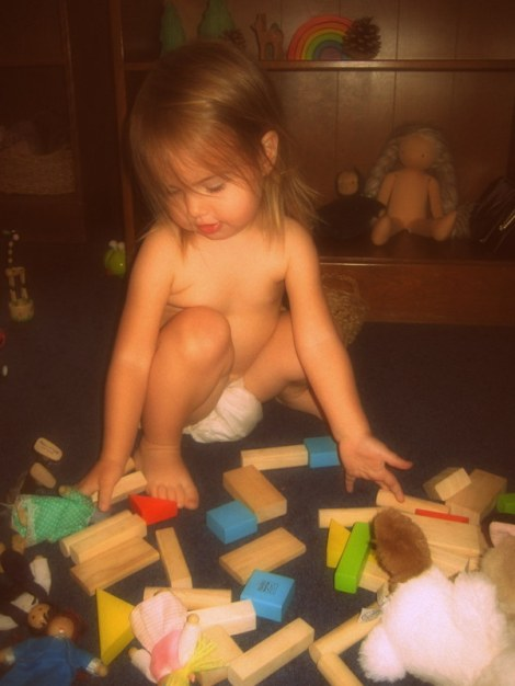 Fae playing with her toys