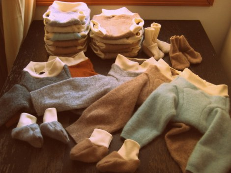 Newborn and small soakers, longies, and booties for our new baby.